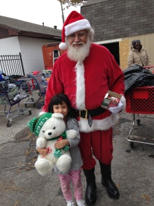 Santa makes a little girl smile!